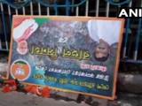 भाजपच्या रोड शो पूर्वी पंतप्रधान नरेंद्र मोदी आणि अमित शहा यांचे पोस्टर्स काढण्यात आले (ANI)