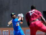 विंडीज गोलंदाजाचा चेंडू फटकवताना टीम इंडियाचा कर्णधार कोहली