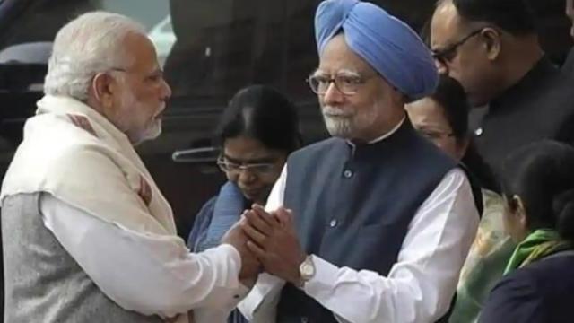 पंतप्रधान नरेंद्र मोदी आणि मनमोहन सिंग